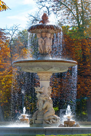 Flowing fountain in Retiro Park of Madrid, Spain on a warm November day.  Warm November day in one of the main parks of the city.