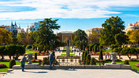 bluesky: Gardens and green space in Retiro Park of Madrid, Spain on a blue-sky sunny day.  Citizens and tourists alike enjoy the gardens on a fabulous warm November day.
