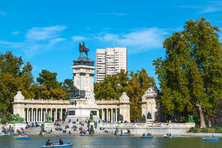 bluesky: Retiro Park of Madrid, Spain on a blue-sky sunny day.  Citizens of Madrid and tourists alike enjoy a fabulous warm November day in one of the main parks. Editorial