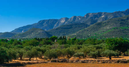 geological feature: Coastal Foothills and mountains of Spain.  Blue sky and Sunshine on Coastal foothills and mountain ranges on the south-eastern edge of continental Spain.