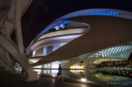 high winds: 7 November, 2013, Valencia, Spain.  The Opera house at Palau de les Arts Reina Sofia, at night, as it appeared just under 3 months before the removal of the ceramic mosaic facade and replacement with paint.  The tiles began to fall off in high  winds, pro Editorial