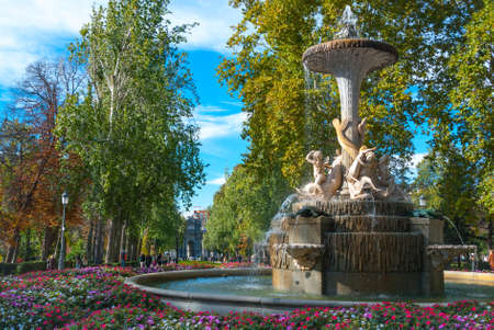 tiered: Lovely fountains in the city of Madrids Retiro park.     Residents and tourists enjoying flowing fountains in Retiro Park, the main park of the city of Madrid, Spain on a warm November day.