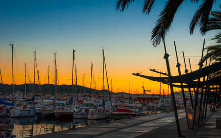 antoni: Marina evening and Dramatic color sundown in St Antoni de Portmany, Ibiza, Balearic Islands, Spain   Boats in marina harbor at the end of a warm sunny day in Ibiza, St Antoni de Portmany Balearic Islands, Spain Stock Photo