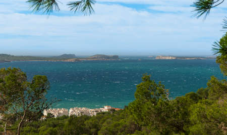 antoni: Panoramic hill side view from St Antoni de Portmany, Ibiza, into balearic sea on a clearing day in November, featuring the oft viewed Conejera islands.