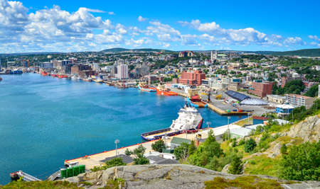 St Johns Harbour in Newfoundland Canada.  Panoramic view of the city. Warm summer day in August from atop the Historically famous Signal Hill in St. Johns. Stock Photo
