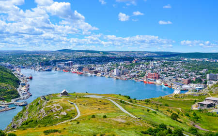St Johns Harbour in Newfoundland Canada.  Panoramic view of the city. Warm summer day in August from atop the Historically famous Signal Hill in St. Johns. Reklamní fotografie