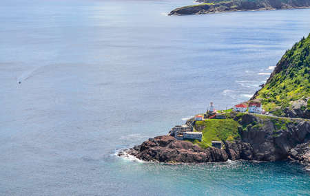 nfld: Summer day over the coastline and cliffs of a Canadian National Historic Site, Fort Amherst in St Johns Newfoundland, Canada.