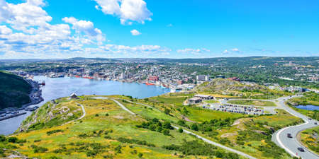 newfoundland: St Johns Harbour in Newfoundland Canada.  Panoramic view of the city. Warm summer day in August from atop the Historically famous Signal Hill in St. Johns. Stock Photo