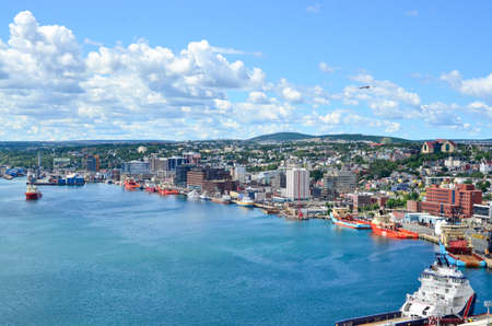 maritimes: St Johns Harbour in Newfoundland Canada.  Panoramic view of the city. Warm summer day in August from atop the Historically famous Signal Hill in St. Johns. Stock Photo