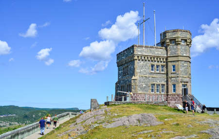 nfld: Radio communications tower, Signal Hill, St. Johns, Newfoundland, Canada.  Tower attracts tourists year round.  Structure still sits perched atop high rugged coastline on Eastern Nfld,   overlooking the Atlantic ocean.