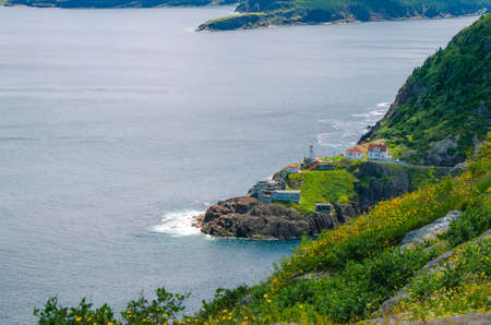 nfld: Canadian National Historic Site, Fort Amherst in St Johns Newfoundland, Rugged coastline and Atlantic ocean. Warm summer day in August.  Views from atop historically famous Signal Hill in St. Johns.
