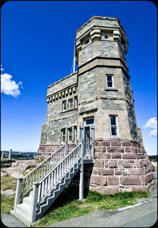Rectilinear wide angle view of entrance to radio communications tower, Signal Hill, St. Johns, Newfoundland, Canada.    Historic site perched atop high rugged coastline, overlooking Atlantic ocean. Stock Photo