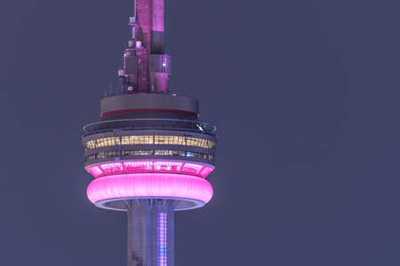 building cn tower: TORONTO - September 8th, 2016: Close up of CN Tower on a hot and hazy humid summer night, September 2016, Toronto, Canada.