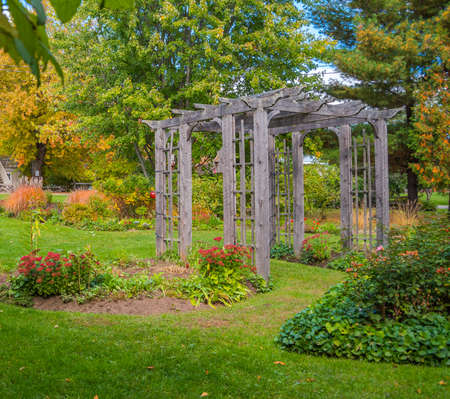 Lovely wedding setting complete with an arboretum in a green floral garden.