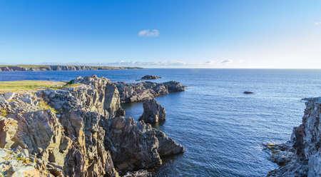 kilometres: Cape Bona Vista coastline in Newfoundland, Canada.  Very distant lighthouse station atop the end of the cape 2 kilometres ahead on the horizon.