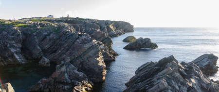 newfoundland: Cape Bona Vista coastline in Newfoundland, Canada.  Lighthouse station atop the end of the cape ahead on the horizon. Stock Photo