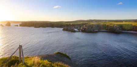 newfoundland: Rear view from road to Cape Bonavista lighthouse station, Newfoundland.  Panoramic vista, bright blue late summer morning over Atlantic Canada.
