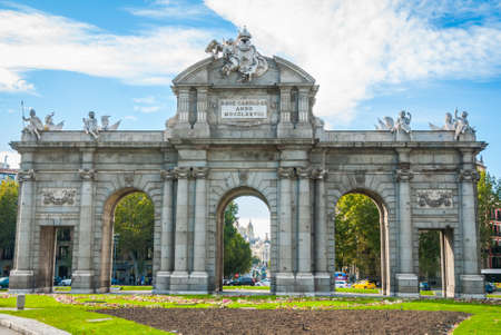 Monument in city of Madrid.   Puerta de Alcalá stands at Plaza de la Independencia in the heart of the city.  It once served to visiting & reigning elite as the gateway to the city.