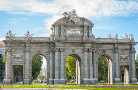 Monument in city of Madrid.   Puerta de Alcala stands at Plaza de la Independencia in the heart of the city.  It once served to visiting & reigning elite as the gateway to the city.