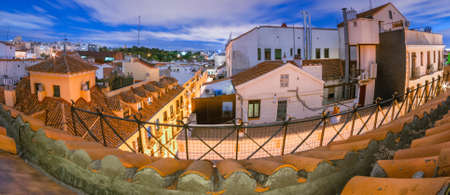 fish eye: Long exposure super wide angle fish eye view of Rooftops of Madrid city.   Terraces some with small garden boxes can be seen on the top floors of apartment buildings.  Rooftop with an partial view to the alley below.
