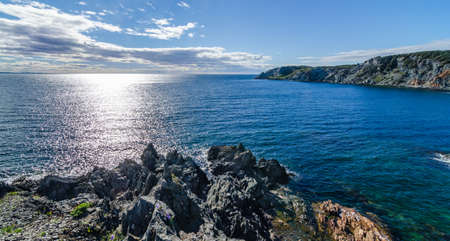 newfoundland: Sun shines bright on the Atlantic Ocean.  View of the cove and the Atlantic from a high cliff in Crow Head, Newfoundland, Canada.