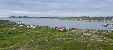 telephone poles: Small village community in Twillingate, Newfoundland.  Houses nestled amongst rocky landscape in Twillingate Newfoundland, Canada.