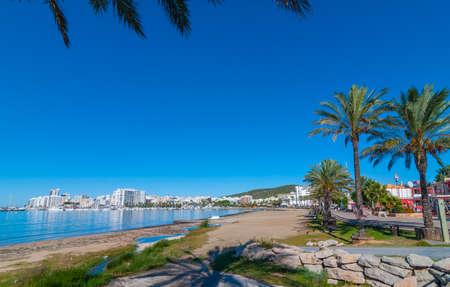 St Antoni de Portmany, Ibiza.  Ibiza sunshine on waterfront and beach in Sant Antoni de Portmany,  Take a walk along main boardwalk or in the sand.