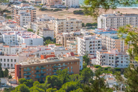 View from the hills in St Antoni de Portmany & surrounding area in Ibiza.  Clearing November day in the bay.  Islands near Spain.  Hotels along the beach, places to stay.