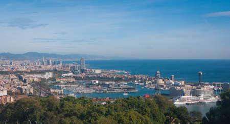 Coastline of Spain in seaside Barcelona.  Balearic sea & coastline of modern cosmopolitan city seen from high, cable car over the city.