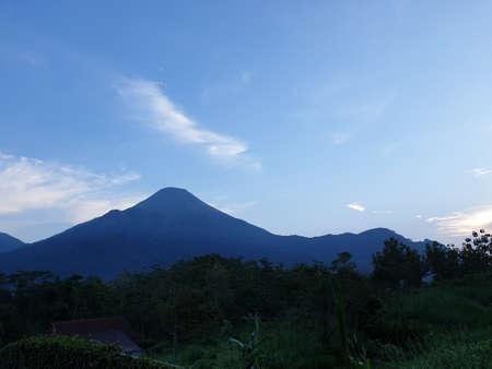Mount Penanggungan with blue sky Banco de Imagens - 129796184