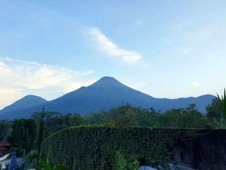 Mount Penanggungan with blue sky Banco de Imagens - 129796186