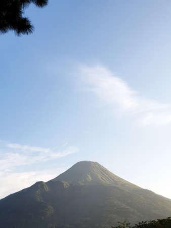 Mount Penanggungan with blue sky Banco de Imagens - 129796185