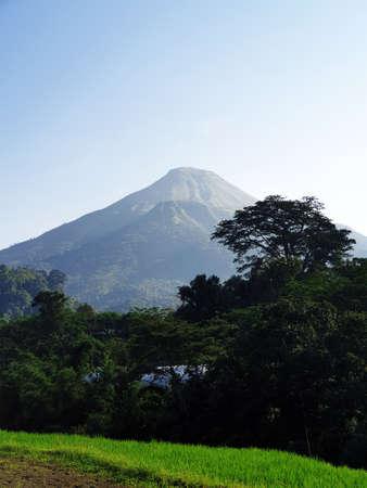 Mount Penanggungan with blue sky Banco de Imagens - 129796202