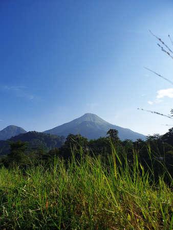 Mount Penanggungan with blue sky Banco de Imagens - 129796207