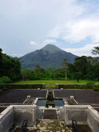 a backyard with Mount Penanggungan view Фото со стока
