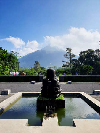 a backyard with Mount Penanggungan view Banco de Imagens - 129796282