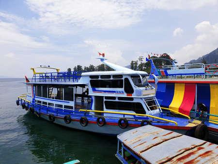 a ship anchored at the port of Lake Toba