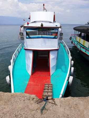 a ship anchored at the port of Lake Toba