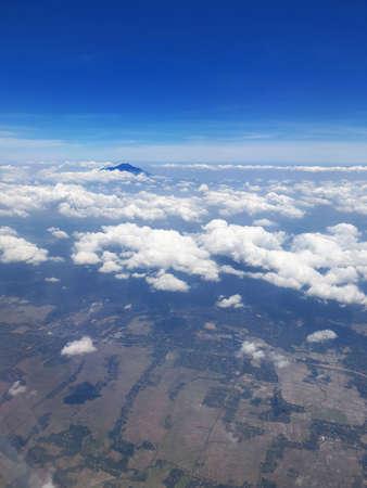 Peak of Mount Slamet taken from airplane above centre of java