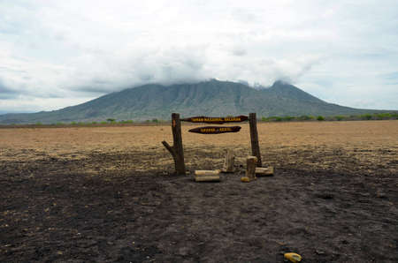 Sign board at Baluran National Park with Mount Baluran in the background, Situbondo, East Java, Indonesia