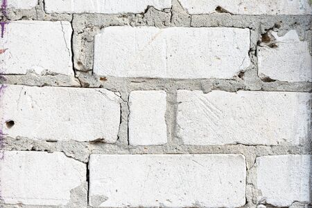 Texture of white brick wall with cement mortar. Background of white silicate brick in the form of brick masonry of rectangular and square bricks