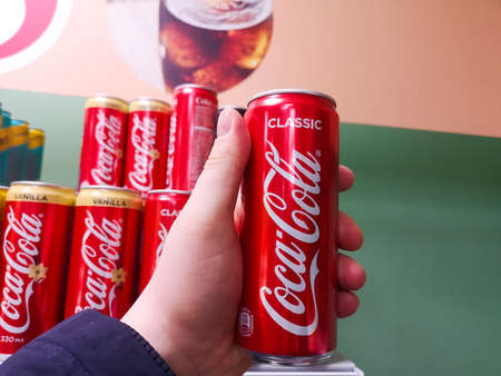 Aluminum can of classic coca cola drink in the buyer 's hand in the shopping center 20.03.2020 in Russia, Tatarstan, Kazan, Spartakovskaya Street 88b. Sajtókép