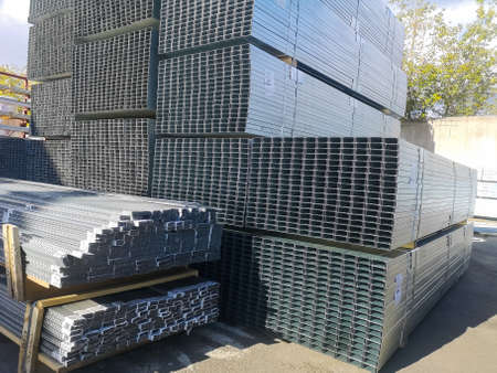 galvanized metal profiles for construction works are packaged at the wholesale building materials base.