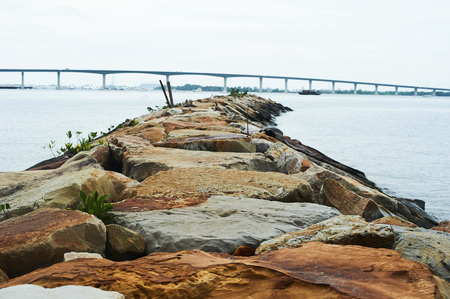 Rock formation overlooking a bridge at Pantai Serasa, Brunei Darussalam