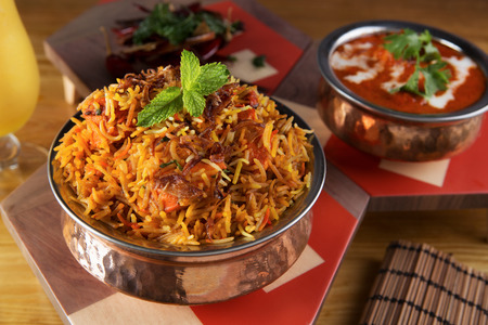 Indian briyani rice in a stainless steel bowl Foto de archivo