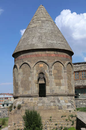 Tomb was built in the 12th century Anatolian Seljuk period. There are two more mausoleums near the cupola made of stone. Erzurum, Turkey. Фото со стока