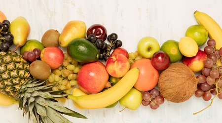 Healthy fruit background ; Studio photo of different fruits on white and  blue  vintage wooden table , high resolution product Stock Photo - 87758833