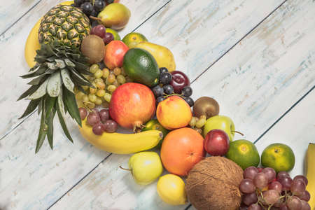 Healthy fruit background ; Studio photo of different fruits on white and  blue  vintage wooden table , high resolution product