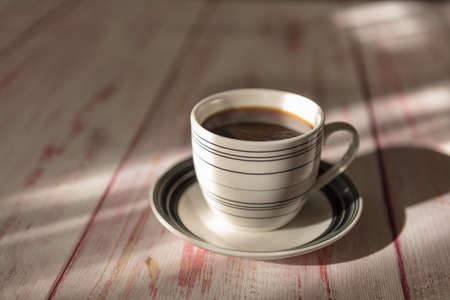 A cup of instant coffee place on old wood background Stock Photo