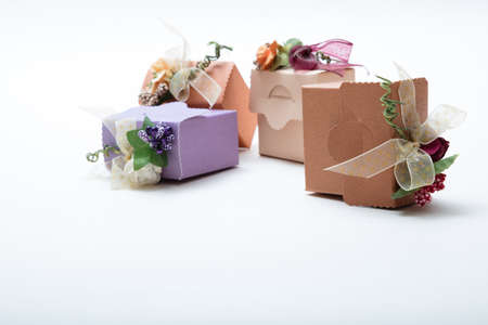Close up view of special kind gift boxes with ribbon and flowers on white backgroung Stock Photo